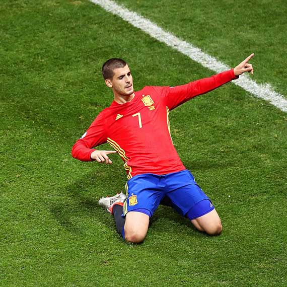 Morata-coolly-slides-on-his